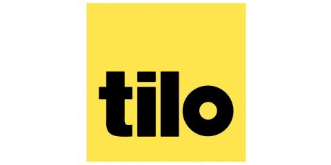 """Gelber Hintergrund und schwarzer Aufschrift """"tilo"""""""